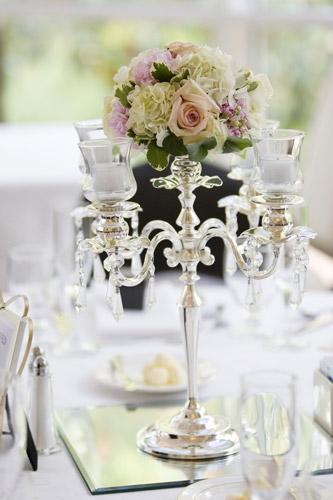 Candelabra centerpieces with flowers garlands wedding